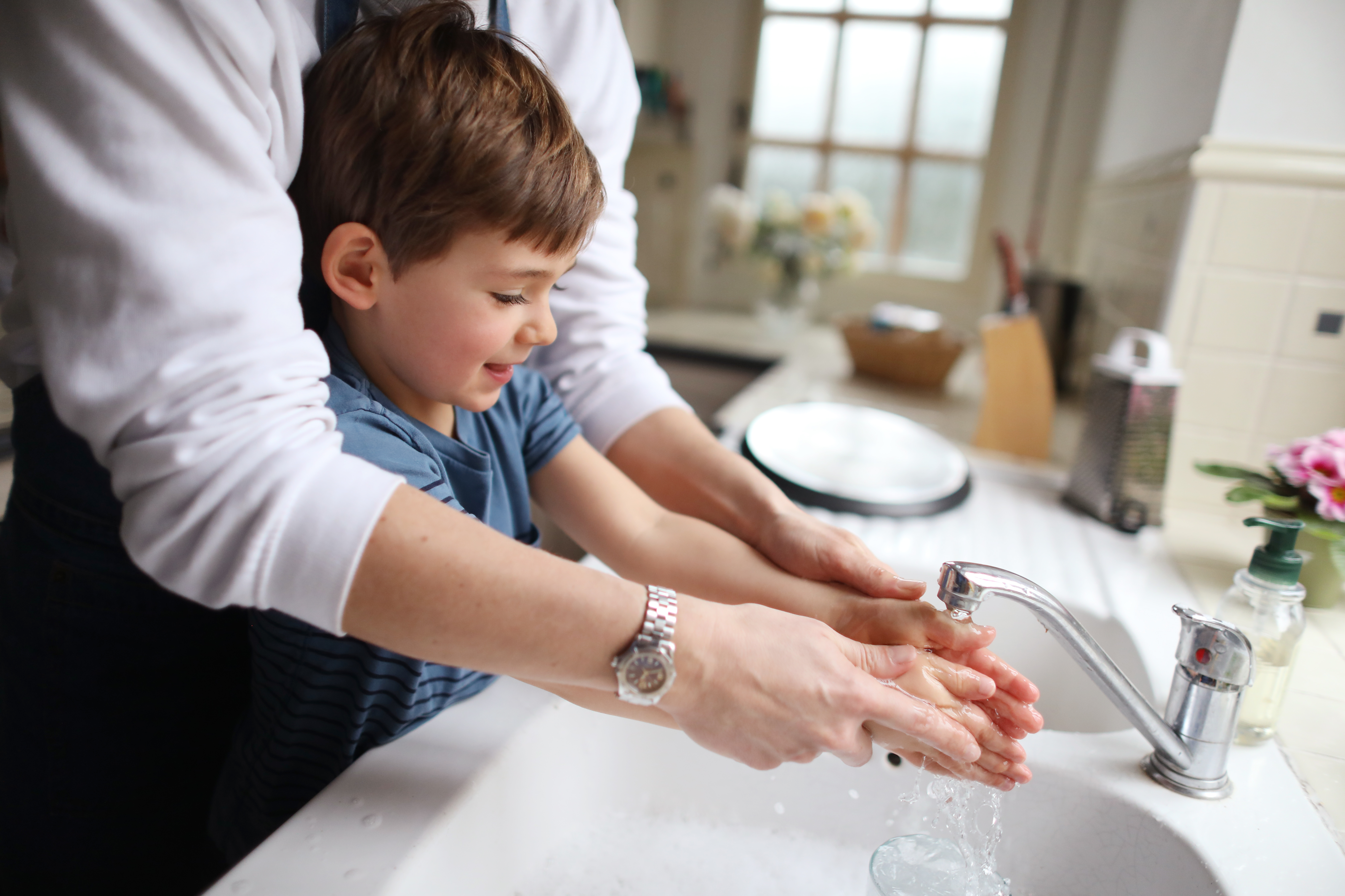 Boy washing his hands